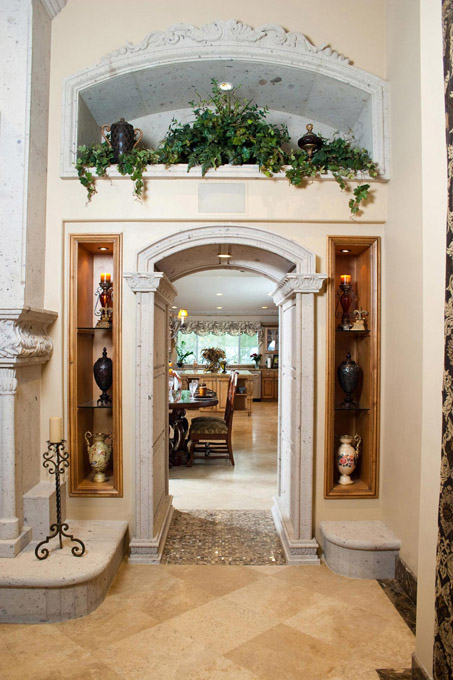 This magnificent archway and decorative niche is expertly hand carved from fine Cantera stone.