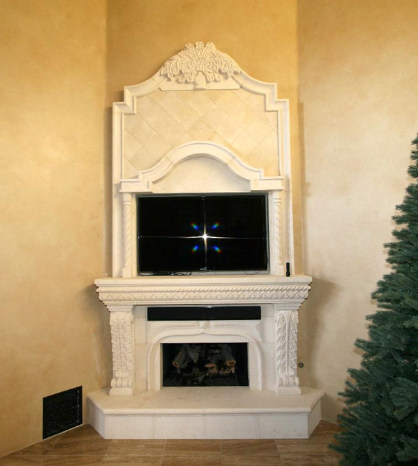 This finely carved fireplace in Limestone will be the focal point of your living room. This fireplace consists of an over mantel, hearth, mantel, and detailed floral crown molding.
